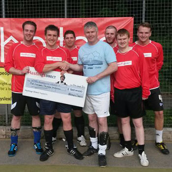 Charity football tournament players