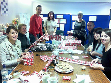 Hastings Direct staff help Santa wrap presents