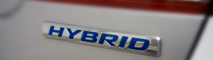 The badge of one of the new hybrid type of cars