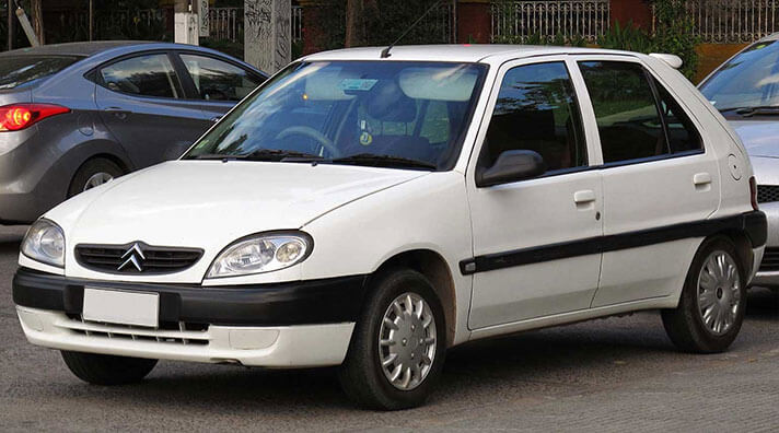 White Citroen Saxo.