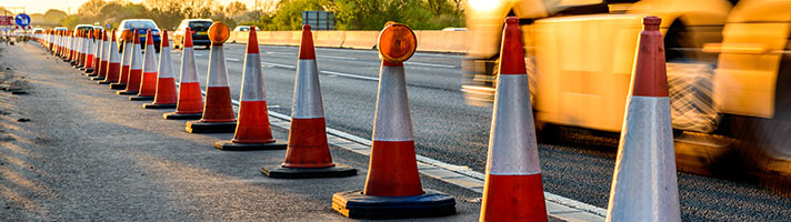 A line of cones on the hard shoulder.