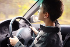 A child driving a car